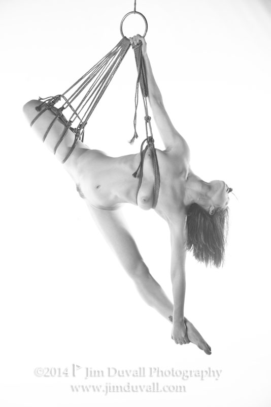 woman tied up and hanging fomr her chest and one leg model: Quinn William