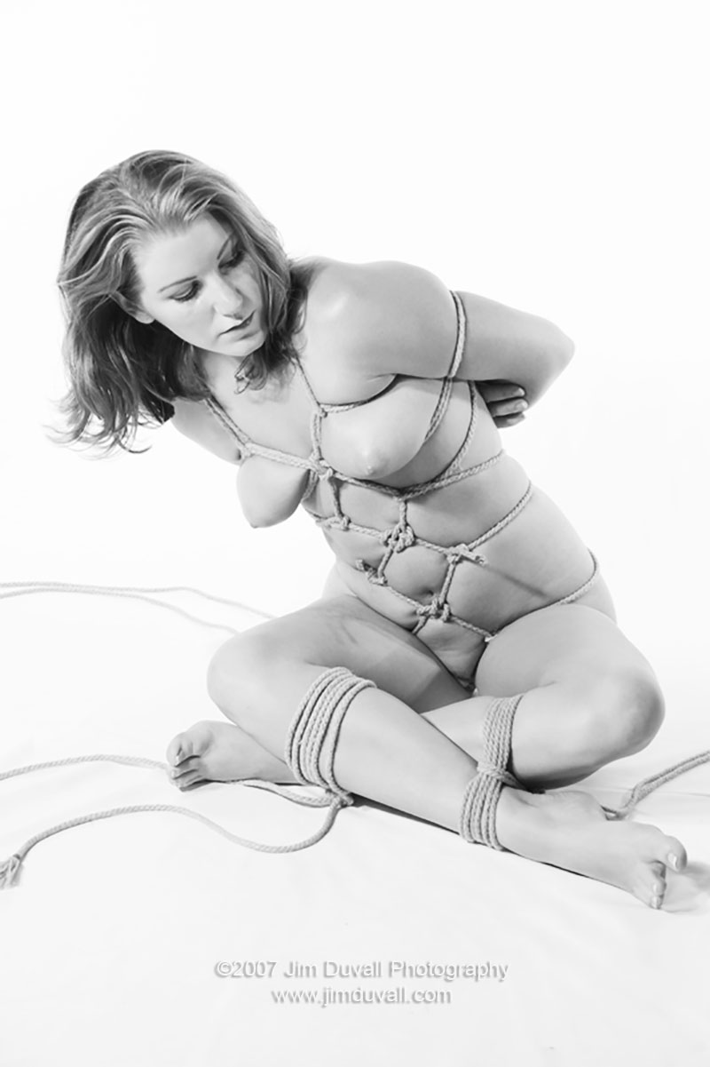 nude woman sitting in a karada tie model: Ashley Edmonds
