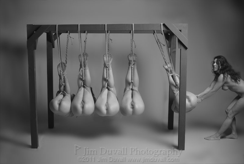 5 women tied up in a Newton's Cradle