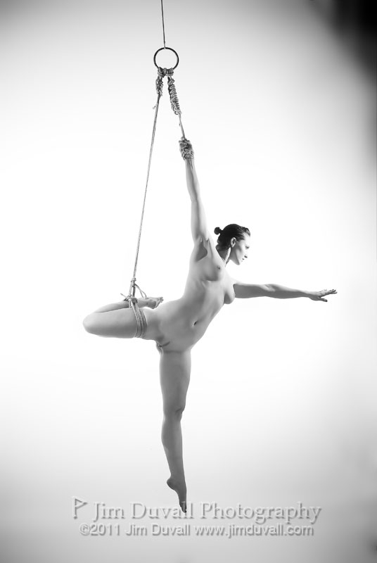 nude woman hung by one leg and one arm Model: Rose Riley