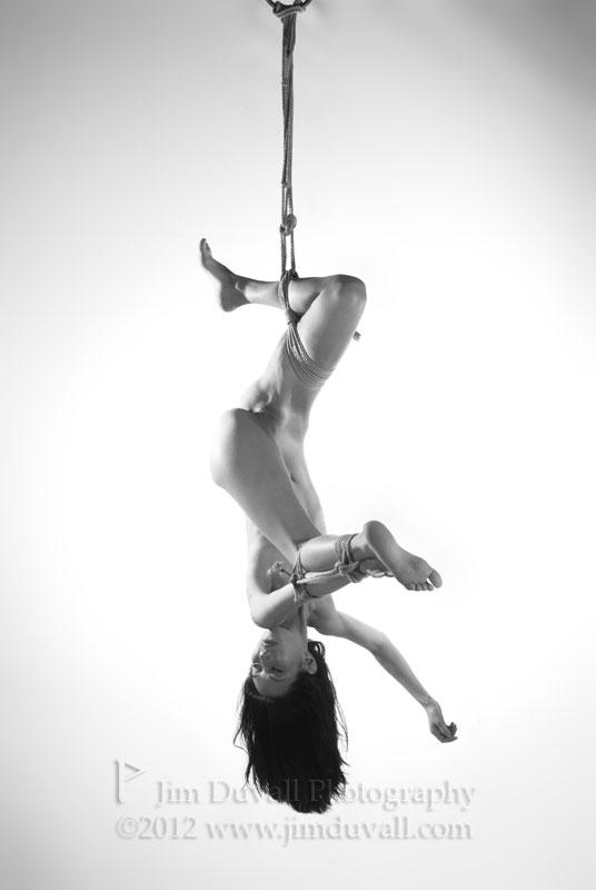 Woman hanging upside down by one leg model: Mitsu