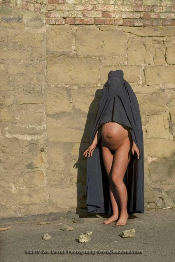 Pregnant woman wearing a burkha