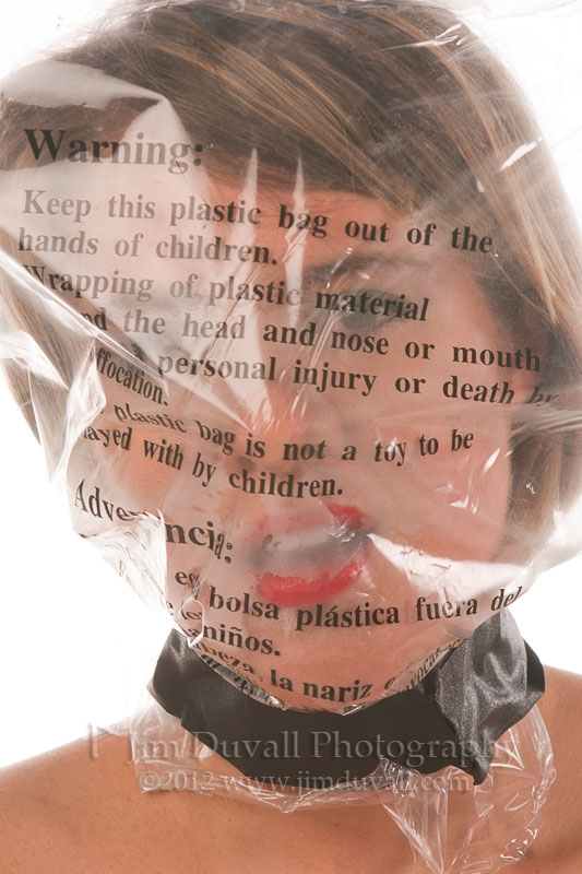 Woman with a plastic bag over her head