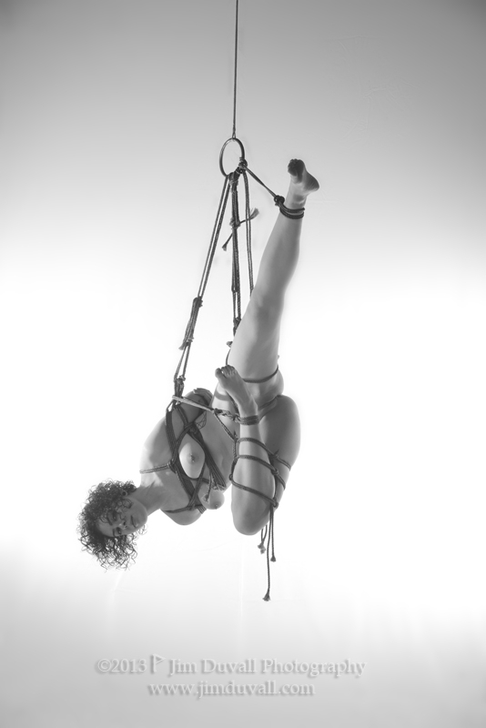 woman tied in rope and supended model: Marlow