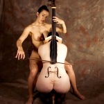 Image a woman playing a womans body strung as a cello