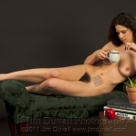 Nude woman reclining with a sudoku puzzle on her hip
