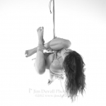 woman tied in an emi ball and suspended upside down model: jo